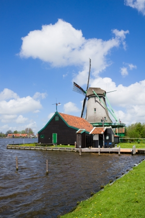 zaan: dutch windmill over Zaan river waters, Holland