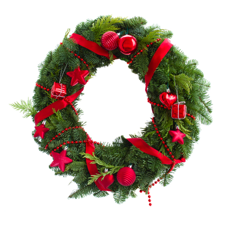 evergreen wreaths: green christmas wreath with red decorations isolated on white