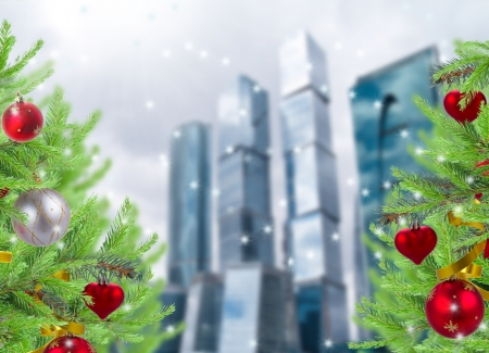christmas decorated trees on big city background photo