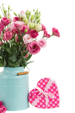Pink eustoma flowers with pink gift box isolated on white photo