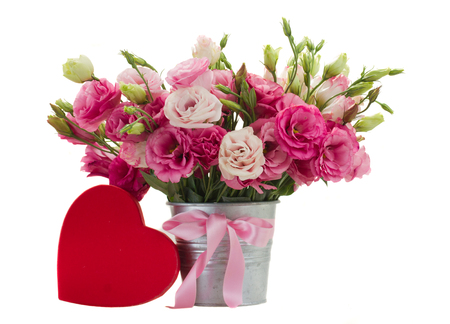 Pink eustoma flowers with red heart  gift box isolated on white photo