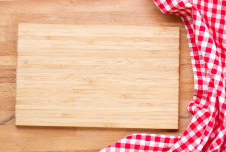empty wooden cutting board  and cloth red napkin photo
