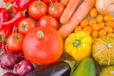 fresh colorful vegetables   - pumpkin, tomatoes, onion and eggplant photo