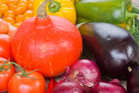 Pumpkin with vegetables   -  tomatoes, onion and eggplant photo