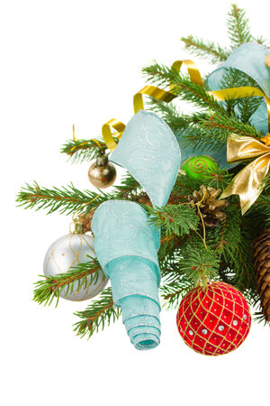 christmas tree with  decorations isolated on white background photo