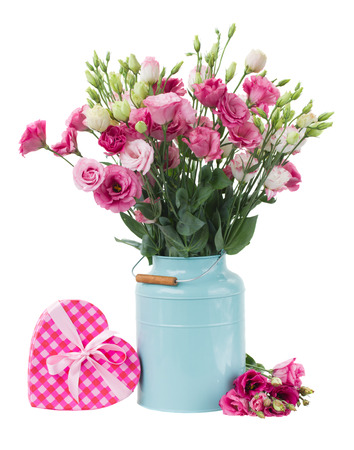 Pink eustoma flowers with pink heart gift box isolated on white photo