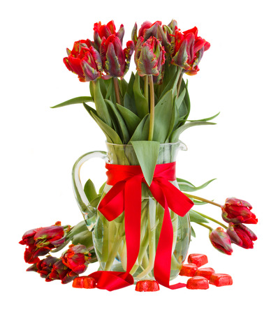 fresh spring red  tulips in vase with hearts  isolated on white background photo