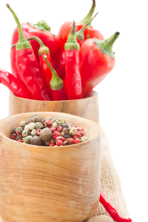 Mix of red pepper  and peppercorn close up  isolated on white background photo