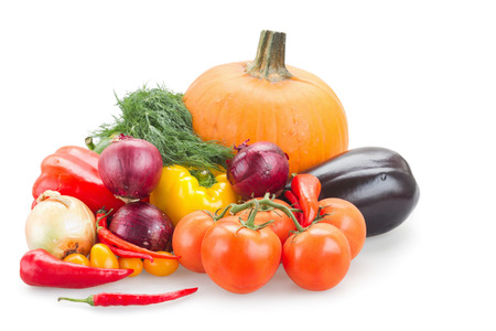 Variety of fresh vegetables isolated over white background photo