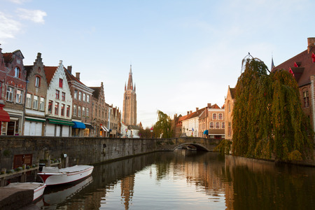 brugge: scene of old town with canal and tower of Vrouwekerk , Belgium