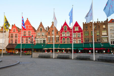 Medieval buildings on the Market Square, Bruges, Belgium photo