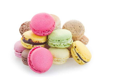 Heap of fresh macaroons isolated over white background photo
