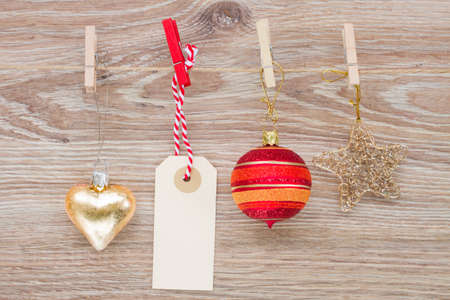 tag with christmas decorations hanging on rope photo