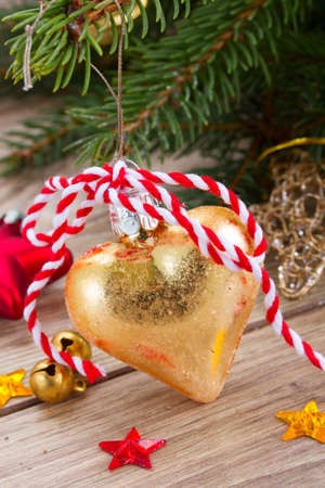 golden heart christmas decoration close up  with evergreen  tree photo