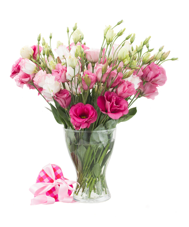 Pink eustoma flowers with  present  box with ribbon  isolated on white photo