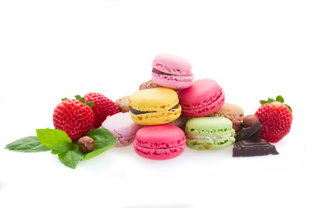 heap of french macaroons with ingredients  isolated on white background photo