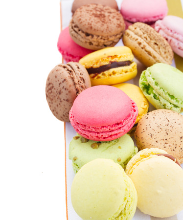 pile of french macaroons border isolated on white background photo