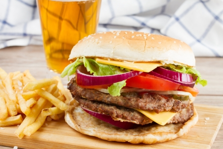 Big fresh  burger with french fries and beer photo