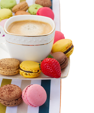 breakfast with macaroons  and coffee as a border isolated on white background photo