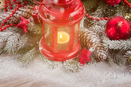 christmas red  lantern with evergreen tree and snow photo