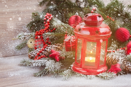 christmas lantern with evergreen tree and snow photo
