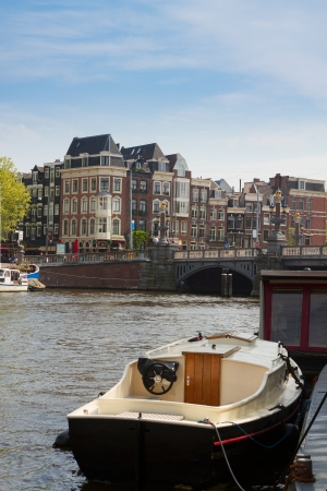 amstel river: Old houses of  Amsterdam on Amstel river, Netherlands