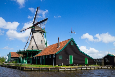 zaan: old dutch windmill over Zaan river waters, Netherland Editorial