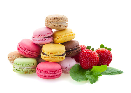 pile of fresh french macaroons with ingredients  isolated on white background photo
