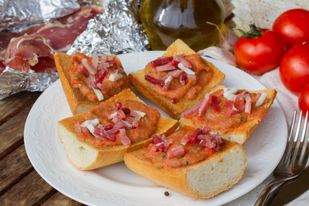spanish tapas    - bread with melted tomatoes and jamon photo