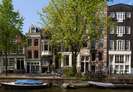old houses over canal  in Amsterdam, Netherlands photo