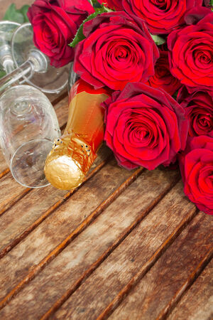 Two glasses and champagne  wine with roses photo