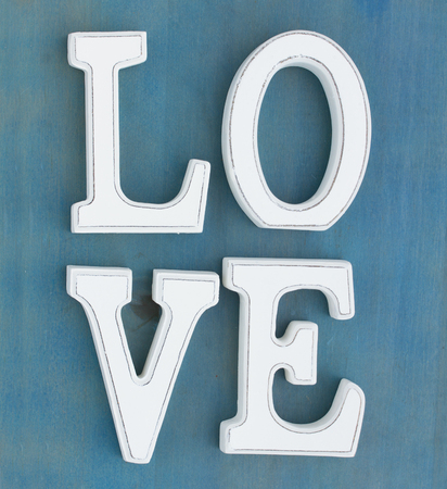 White letters Love on blue wooden background Stock Photo - 25168334