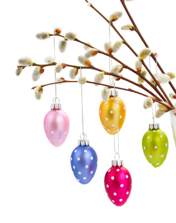 Hanging multicolored easter eggs isolated on white bacjground photo