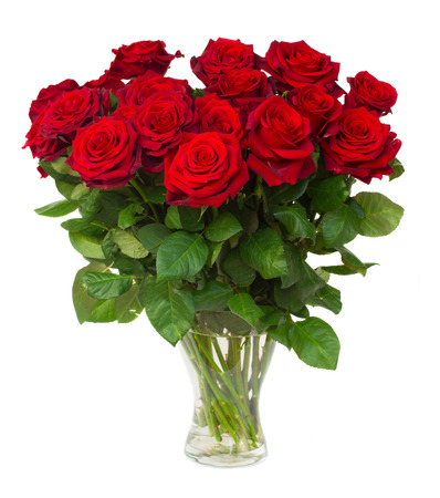 bouquet of blossoming dark red roses in vase isolated on white
