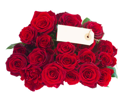 bouquet of dark red roses with tag  isolated on white  photo