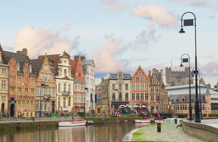 Old historical   buildings on Graslei harbor at day, Ghent, Belgium photo