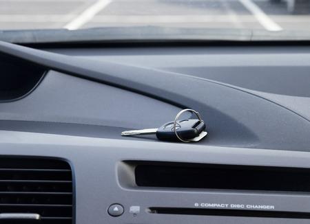 car remote control key laying on car dashbosrd photo