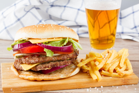 Big fresh  hamburger with french fries and beer photo