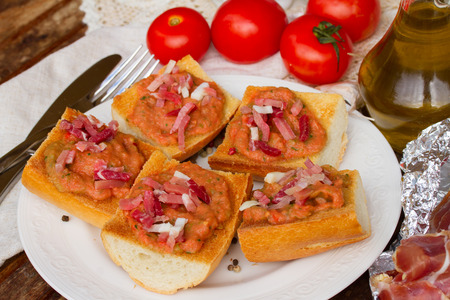 spanish tapas    - plate of  bread with melted tomatoes and jamon photo