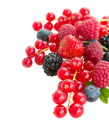 Pile of fresh berries isolated on white background photo