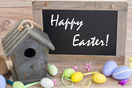 easter decoration with eggs . vintage style background with sample text Happy Easter! photo