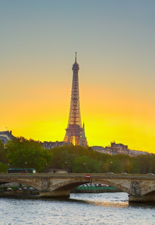 Eiffel tower over Alexandre III Bridgeat at sunset,  Paris, France. HDR. photo
