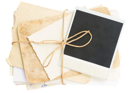 pile of old mail and aged photos  isolated on white  photo