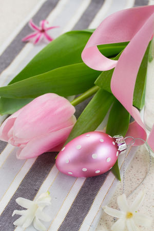 one pastel pink easter egg with tulip photo