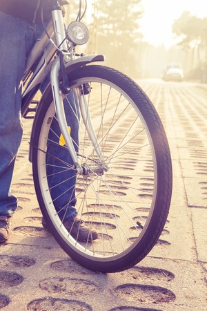 close up of bike with front wheel, , retro toned Stock Photo - 26496420