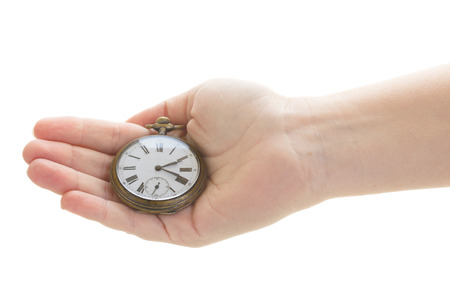 ancient pass: time concept - hand holding antique clock isolated on white background Stock Photo