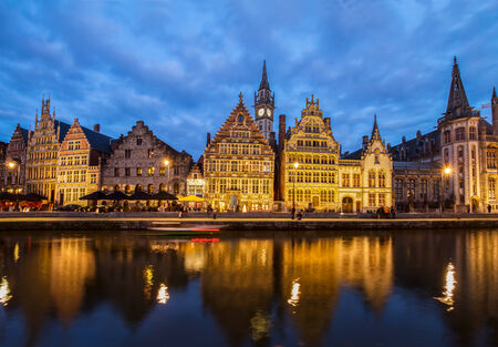 Embankment of old town at blue night, Ghent, Belgium photo