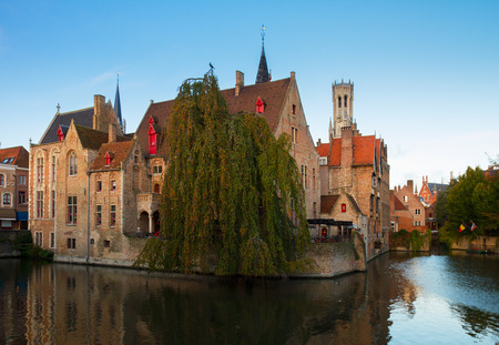 view of old town of Bruges with Belfort tower amd canals, Belgium photo