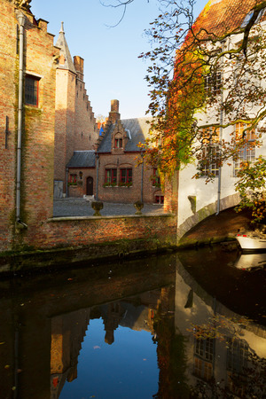 small street of old Bruges with canal, Belgium photo