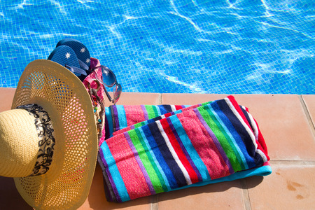 pool side: towel and bathing accessories near pool  side Stock Photo